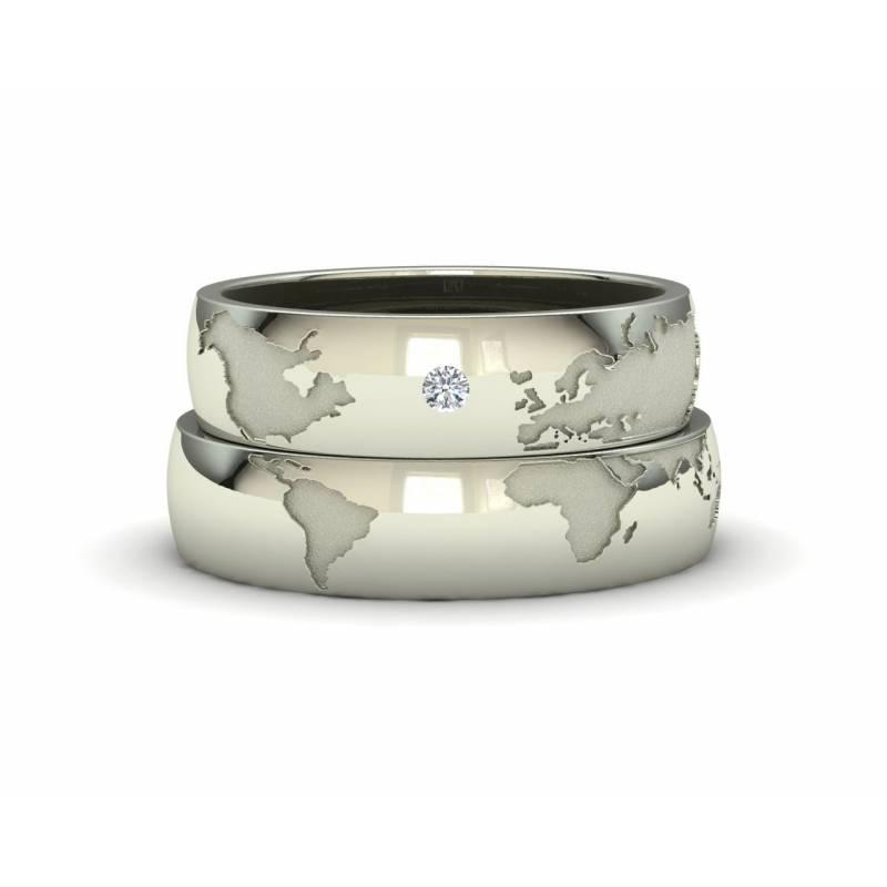 Alianzas mapamundi en oro blanco 5mm con un diamante
