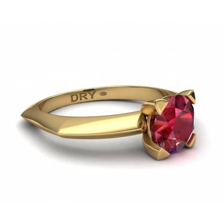 Anillo de compromiso con un  rubí en oro amarillo de 18k